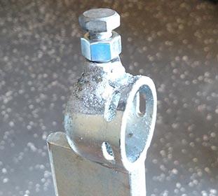 Adjustment bolt and nut installed on receiver end